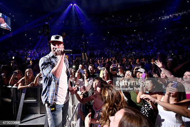 Recording artist Sam Hunt performs in the audience during the 2015 iHeartRadio Country Festival at The Frank Erwin Center on May 2 2015 in Austin...