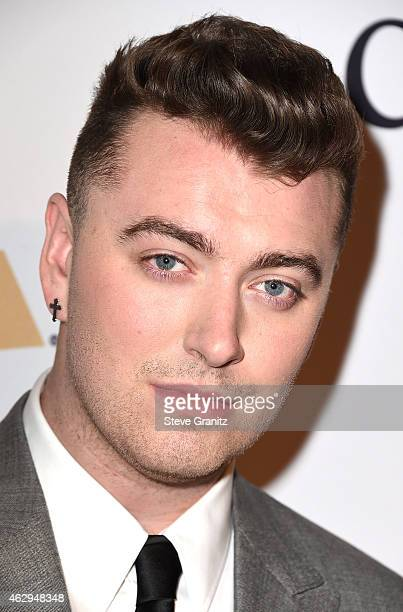 Recording artist Sam Smith attends the PreGRAMMY Gala and Salute To Industry Icons honoring Martin Bandier on February 7 2015 in Los Angeles...