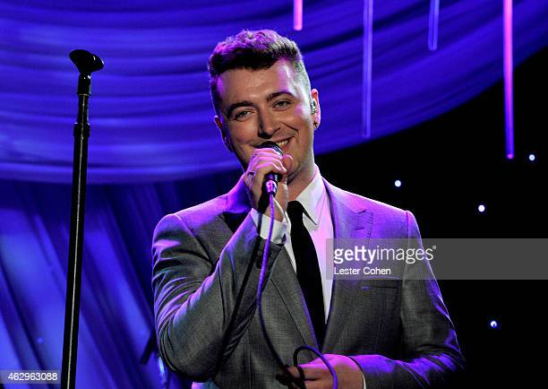 Recording artist Sam Smith performs onstage at the PreGRAMMY Gala and Salute To Industry Icons honoring Martin Bandier at The Beverly Hilton Hotel on...
