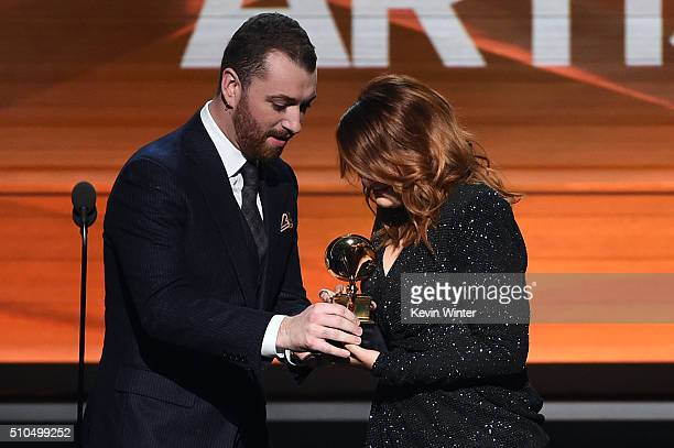 Recording artist Sam Smith presents the Best New Artist award to recording artist Meghan Trainor onstage during The 58th GRAMMY Awards at Staples...