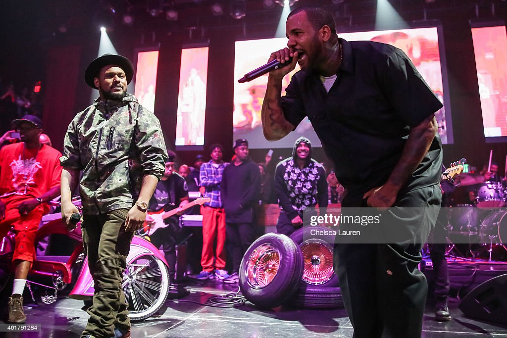 Recording artist Schoolboy Q (L) and rapper The Game on stage at 'The Documentary' 10th anniversary party and concert on January 18, 2015 in Los Angeles, California.