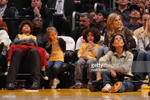 Recording Artist Seal and wife Heidi Klum watch a game between the New Orleans Hornets and the Los Angeles Lakers with their children Henry Leni and...
