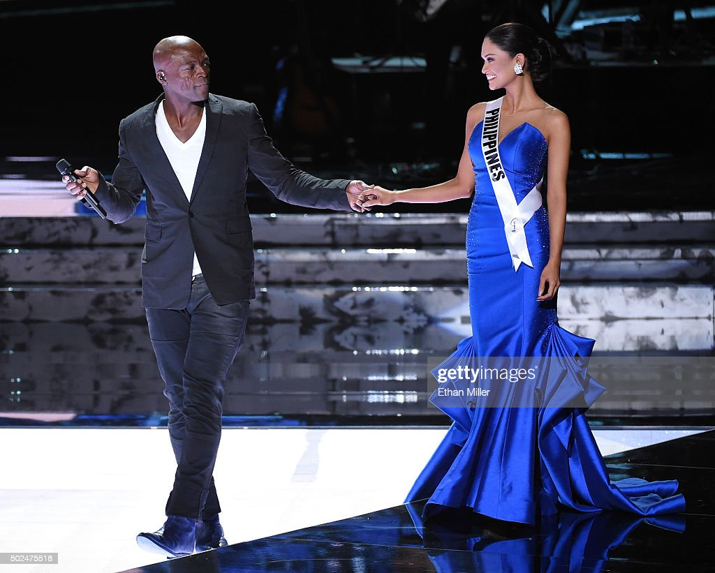 Recording artist Seal (L) performs as Miss Philippines 2015, Pia Alonzo Wurtzbach, walks onstage during the 2015 Miss Universe Pageant at The Axis at Planet Hollywood Resort & Casino on December 20, 2015 in Las Vegas, Nevada. Wurtzbach went on to be be named the new Miss Universe.