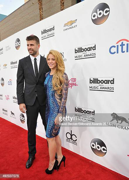Recording artist Shakira and professional soccer player Gerard Pique attend the 2014 Billboard Music Awards at the MGM Grand Garden Arena on May 18...