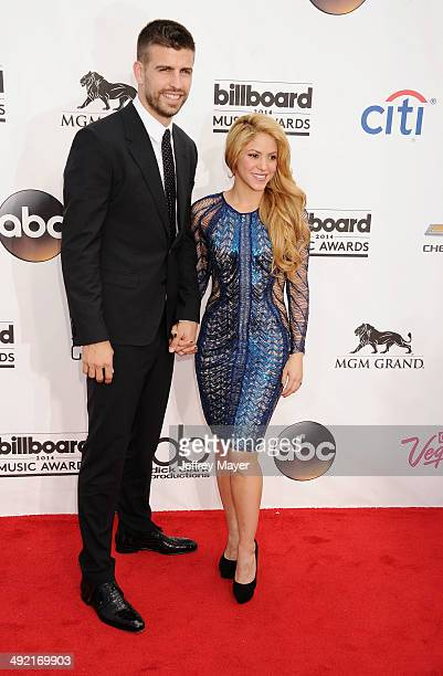 Recording artist Shakira and soccer player Gerard Pique arrive at the 2014 Billboard Music Awards at the MGM Grand Garden Arena on May 18 2014 in Las...