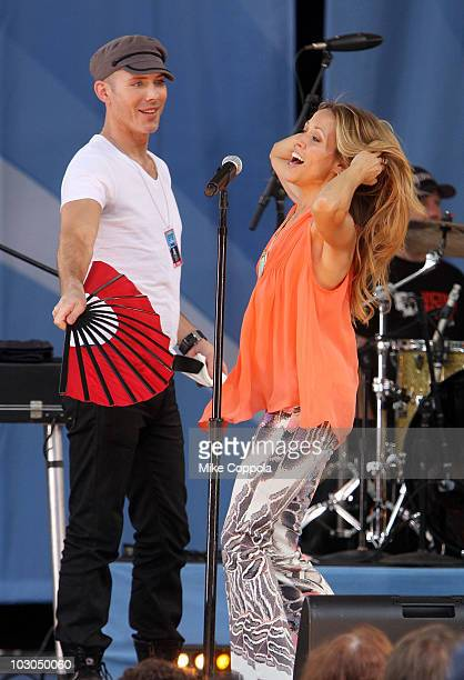 Recording artist Sheryl Crow is fanned before she performs on ABC's 'Good Morning America' at Rumsey Playfield on July 23 2010 in New York City