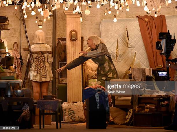 Recording artist Sia and actress Kristen Wiig perform onstage during The 57th Annual GRAMMY Awards at the STAPLES Center on February 8 2015 in Los...