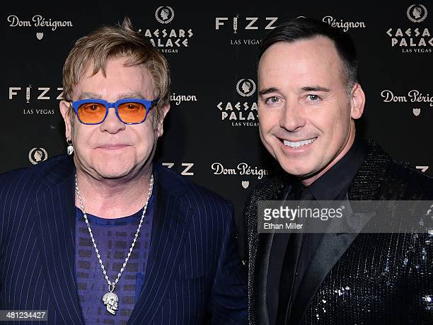 Recording artist Sir Elton John and his partner Fizz Las Vegas creative director David Furnish arrive at the grand opening of Fizz Las Vegas inside...