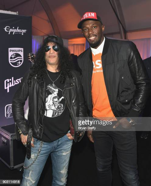 Recording artist Slash and sprinter Usain Bolt attend the Gibson rocks opening of CES 2018 at the Las Vegas Convention Center on January 9 2018 in...