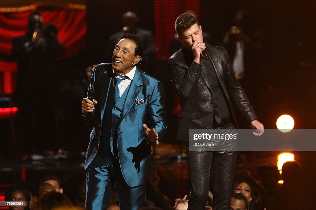 Recording artist Smokey Robinson and Robin Thicke perform on stage at the 2015 BET Awards on June 28, 2015 in Los Angeles, California.