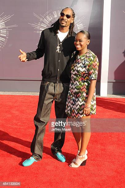Recording artist Snoop Dogg and Cori Broadus attend the 2014 MTV Video Music Awards at The Forum on August 24 2014 in Inglewood California