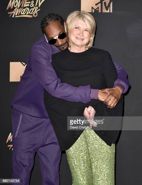 Recording artist Snoop Dogg and TV personality Martha Stewart pose in the press room during the 2017 MTV Movie And TV Awards at The Shrine Auditorium...