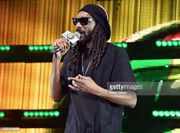 Recording artist Snoop Dogg performs with singer Sam Hunt onstage during 2016 Stagecoach California's Country Music Festival at Empire Polo Club on...