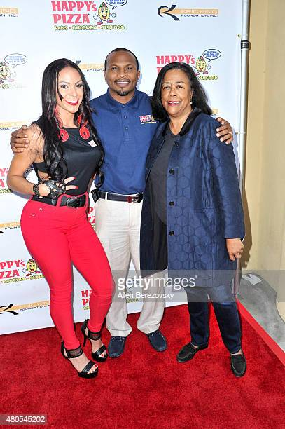 Recording artist Soulfia King former NFL player Eric King and the general manager of Economic and Workforce Development Department Jan Perry attend...