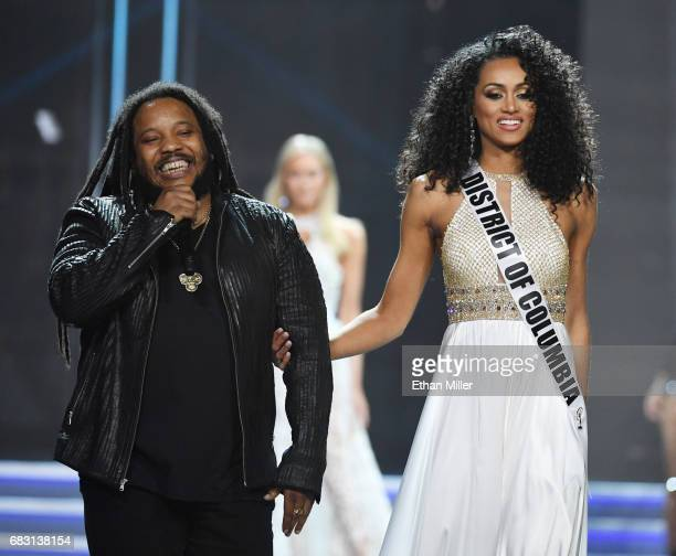 Recording artist Stephen Marley performs while escorting Miss District of Columbia USA 2017 Kara McCullough onstage during the 2017 Miss USA pageant...