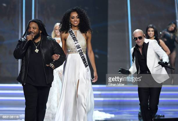 Recording artist Stephen Marley sings while escorting Miss District of Columbia USA 2017 Kara McCullough onstage as rapper Pitbull performs during...