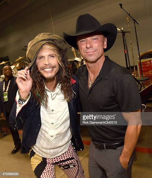 Recording artist Steven Tyler and honoree Kenny Chesney pose backstage at the 50th Academy of Country Music Awards at ATT Stadium on April 19 2015 in...