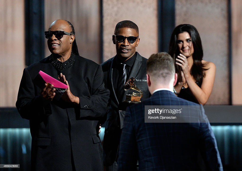 Recording artist Stevie Wonder, actor/singer Jamie Foxx and singer Sam Smith (back to camera) appear onstage during The 57th Annual GRAMMY Awards at the at the STAPLES Center on February 8, 2015 in Los Angeles, California.