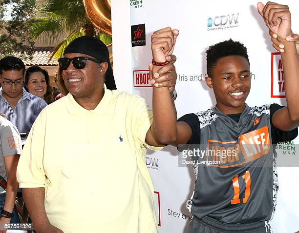Recording artist Stevie Wonder and son Kailand Morris attend the 4th Annual Kailand Obasi HoopLife Fundraiser at USC Galen Center on August 28 2016...