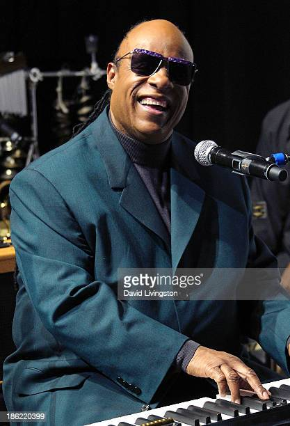 Recording artist Stevie Wonder performs at a press conference announcing the 18th Annual House Full of Toys Benefit Concert at Club Nokia on October...