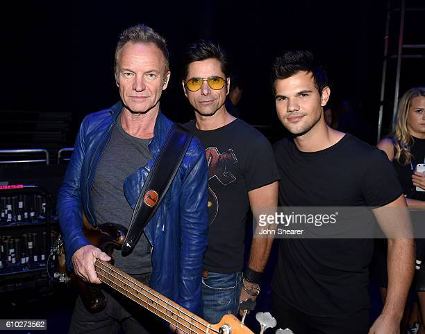 Recording artist Sting actor John Stamos and actor Taylor Lautner pose backstage at the 2016 iHeartRadio Music Festival at TMobile Arena on September...