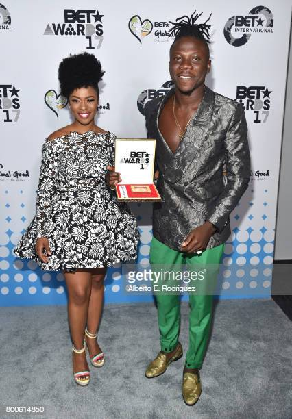 Recording artist Stonebwoy and guest attend the 2017 BET International Awards Presentation at Microsoft Theater on June 24 2017 in Los Angeles...