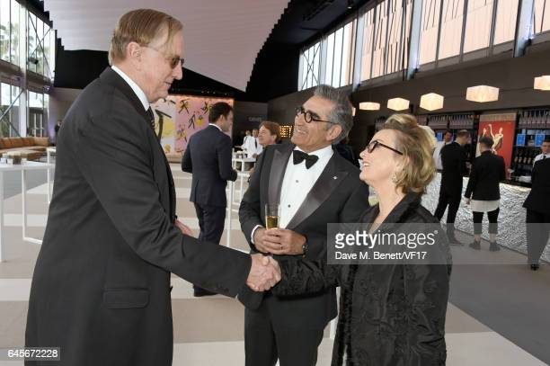 Recording artist T Bone Burnett actor Eugene Levy and Deborah Divine attend the 2017 Vanity Fair Oscar Party hosted by Graydon Carter at Wallis...