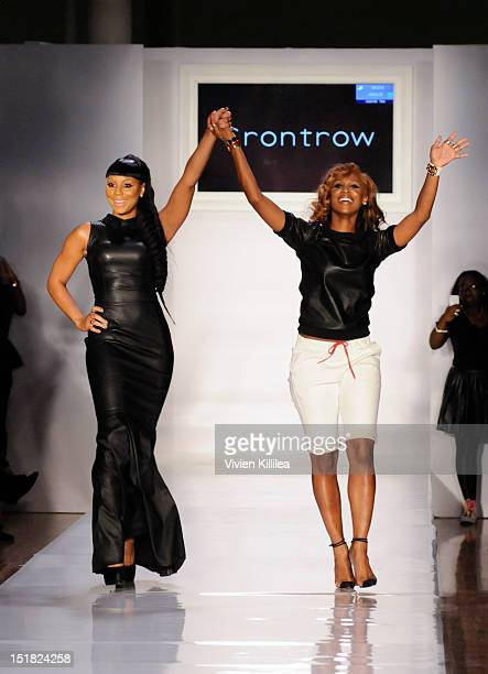 Recording artist Tamar Braxton and fashion designer Shateria MoragneEL walk the runway at Front Row at the Bonkuk Koo spring 2013 fashion show during...