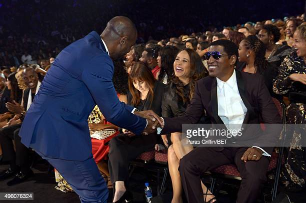 Recording artist Tank greets honoree Kenneth 'Babyface' Edmonds during the 2015 Soul Train Music Awards at the Orleans Arena on November 6 2015 in...