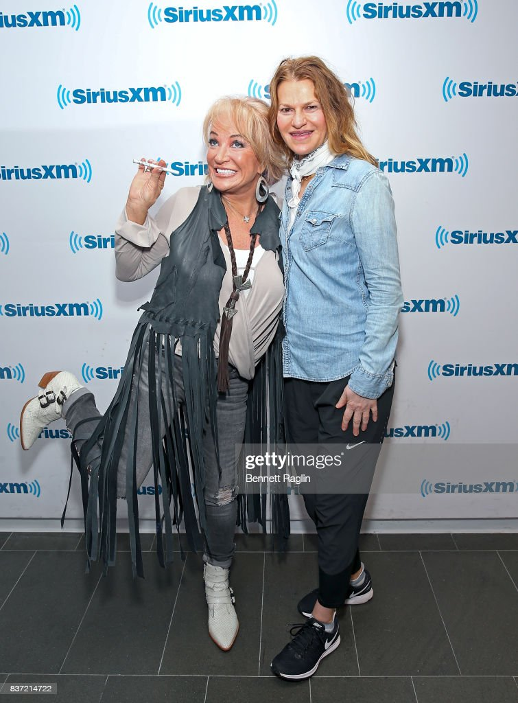 Recording artist Tanya Tucker and SiriusXM host Sandra Bernhard pose for a picture at SiriusXM Studios on August 22, 2017 in New York City.