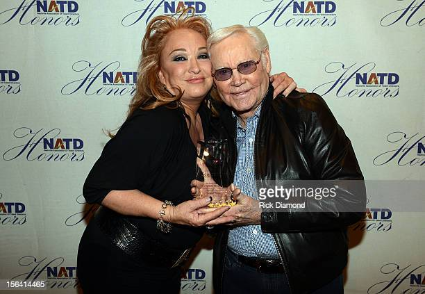 Recording Artist Tanya Tucker presents Singer/Songwriter George Jones his NATD Award during the 2012 NATD Honors at The Hermitage Hotel on November...