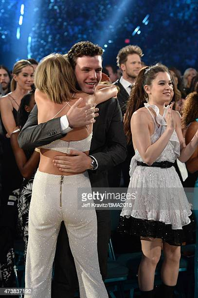 Recording artist Taylor Swift and Austin Swift embrace at the 2015 Billboard Music Awards at MGM Grand Garden Arena on May 17 2015 in Las Vegas Nevada