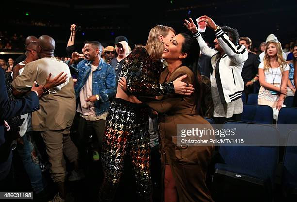 Recording artist Taylor Swift and TV personalities Kim Kardashian embrace during the 2015 MTV Video Music Awards at Microsoft Theater on August 30...