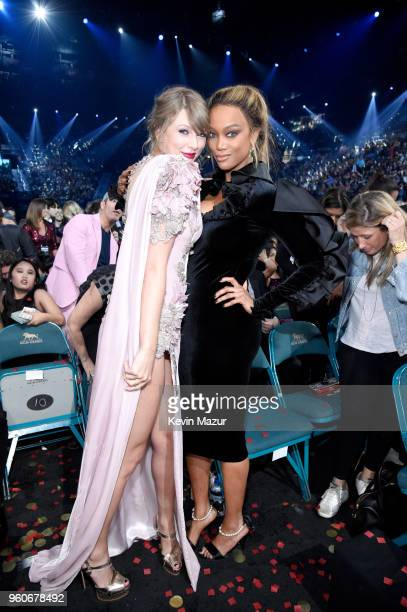 Recording artist Taylor Swift and TV personality Tyra Banks attend the 2018 Billboard Music Awards at MGM Grand Garden Arena on May 20 2018 in Las...