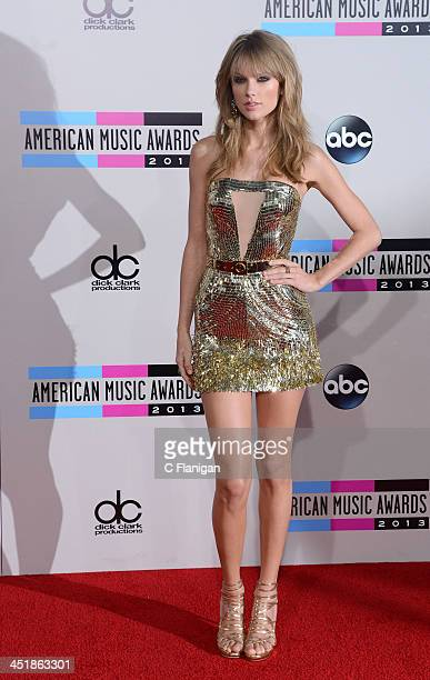 Recording artist Taylor Swift arrives at the 2013 American Music Awards at Nokia Theatre LA Live on November 24 2013 in Los Angeles California