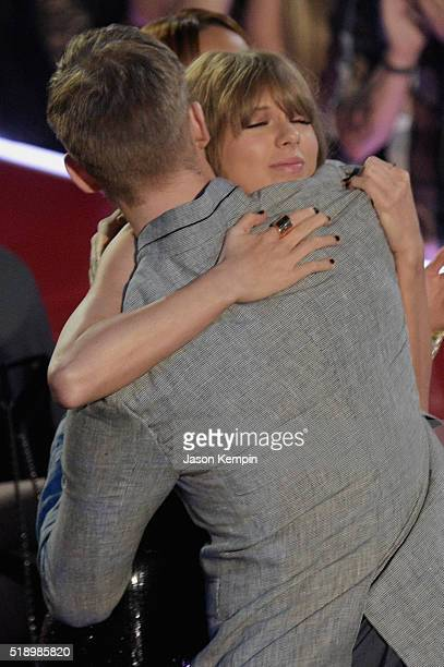 Recording artist Taylor Swift hugs Calvin Harris at the iHeartRadio Music Awards which broadcasted live on TBS TNT AND TRUTV from The Forum on April...