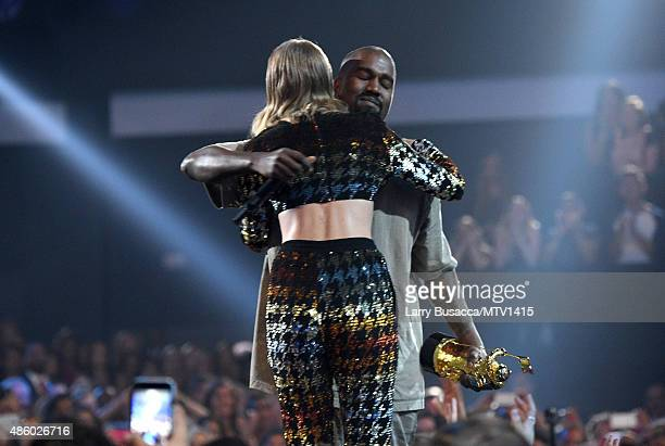 Recording artist Taylor Swift hugs recording artist Kanye West after presenting him with the Vanguard Award onstage during the 2015 MTV Video Music...