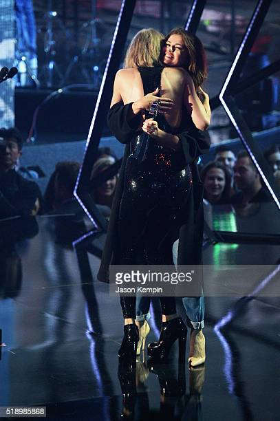 Recording artist Taylor Swift hugs Selena Gomez at the iHeartRadio Music Awards which broadcasted live on TBS, TNT, AND TRUTV from The Forum on April...