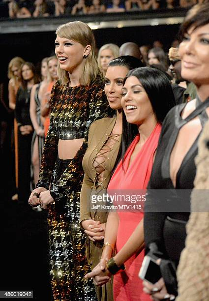 Recording artist Taylor Swift TV personalities Kim Kardashian Kourtney Kardashian and Kris Jenner during the 2015 MTV Video Music Awards at Microsoft...