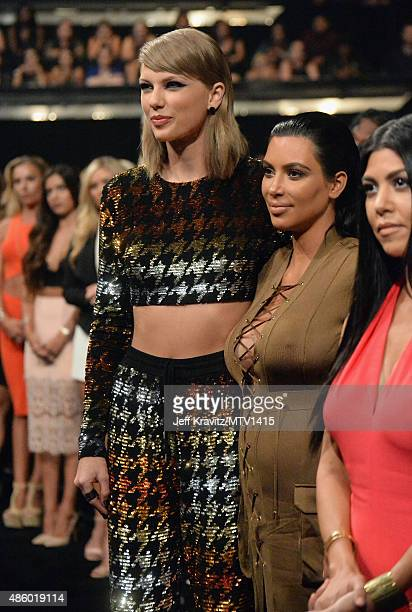 Recording artist Taylor Swift TV personalities Kim Kardashian and Kourtney Kardashian during the 2015 MTV Video Music Awards at Microsoft Theater on...