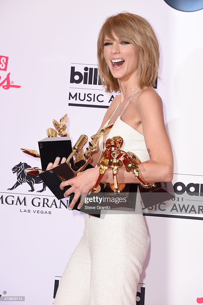 Recording artist Taylor Swift, winner of Top Artist, Top Female Artist, Top Billboard 200 Artist, Top Billboard 200 Album for '1989,' Top Hot 100 Artist, Top Digital Songs Artist, Top Streaming Song (Video) for 'Shake It Off,' and Billboard Chart Achievement Award, poses in the press room during the 2015 Billboard Music Awards at MGM Grand Garden Arena on May 17, 2015 in Las Vegas, Nevada.
