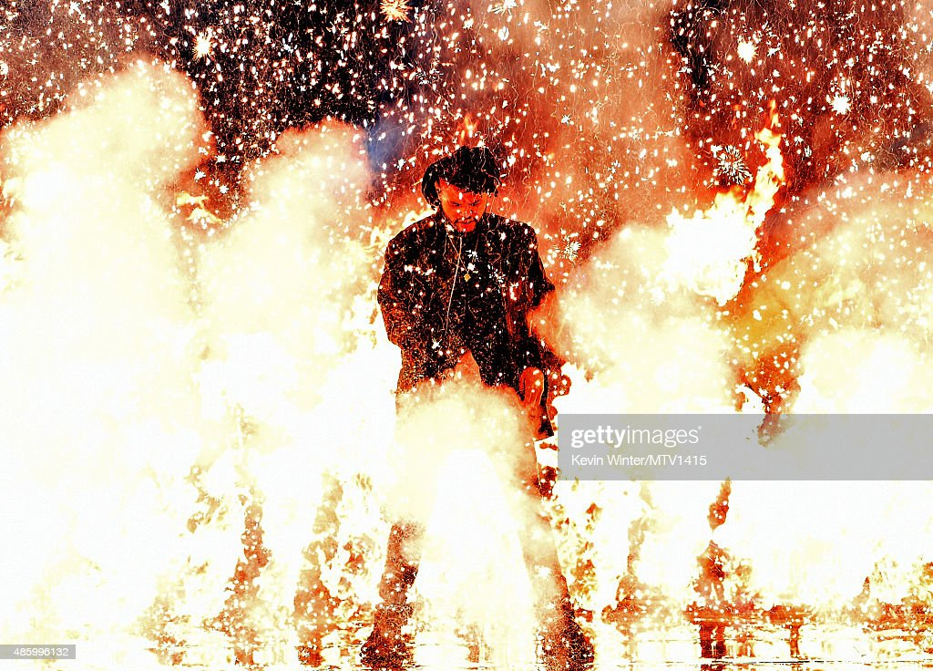 Recording artist The Weeknd performs onstage during the 2015 MTV Video Music Awards at Microsoft Theater on August 30, 2015 in Los Angeles, California.