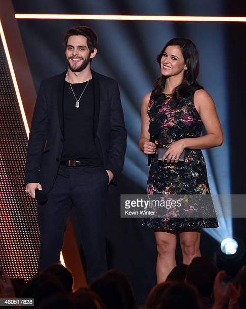 Recording artist Thomas Rhett and actress Melissa Fumero speak onstage during the 2014 American Country Countdown Awards at Music City Center on...