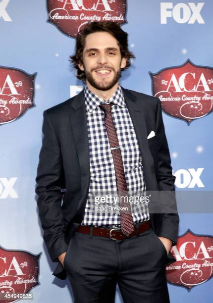Recording artist Thomas Rhett arrives at the American Country Awards 2013 at the Mandalay Bay Events Center on December 10 2013 in Las Vegas Nevada