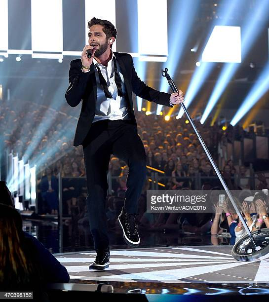 Recording artist Thomas Rhett performs onstage during the 50th Academy of Country Music Awards at ATT Stadium on April 19 2015 in Arlington Texas