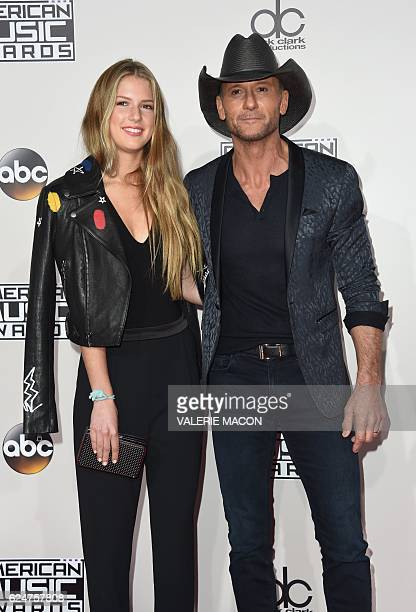 Recording artist Tim McGraw arrives with Maggie Elizabeth McGraw for the 2016 American Music Awards November 20 2016 at the Microsoft Theater in Los...