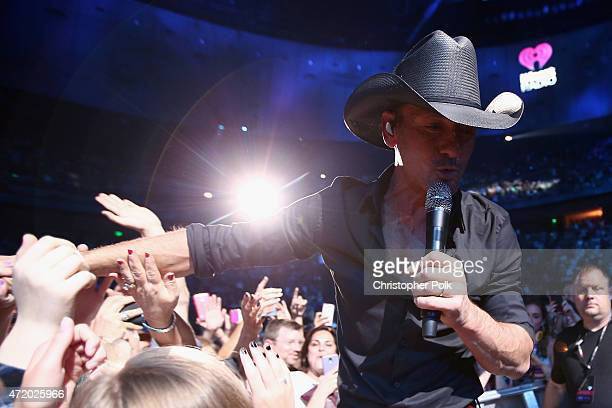 Recording artist Tim McGraw performs in the audience during the 2015 iHeartRadio Country Festival at The Frank Erwin Center on May 2 2015 in Austin...
