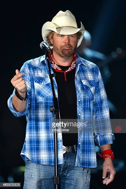 Recording artist Toby Keith accepts USO award onstage during ACM Presents An AllStar Salute To The Troops at the MGM Grand Garden Arena on April 7...