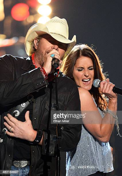 Recording artist Toby Keith and singer Mica Roberts perform onstage during the 49th Annual Academy of Country Music Awards at the MGM Grand Garden...