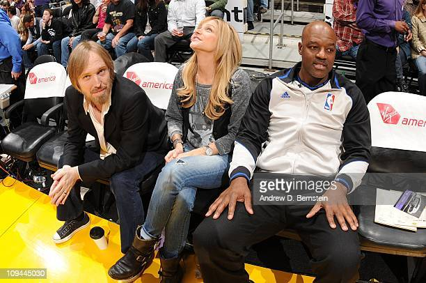 Recording artist Tom Petty and his wife Dana York sit next to official Haywoode Workman before a game between the Los Angeles Clippers and the Los...